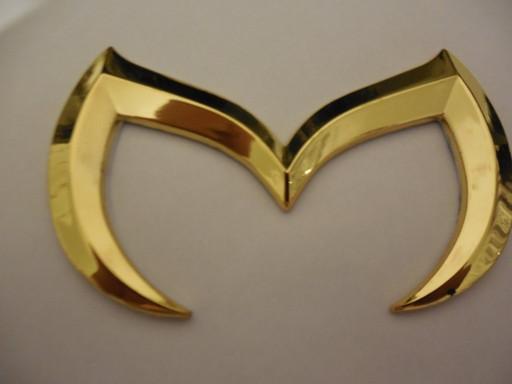 Эмблема Мазда золотая