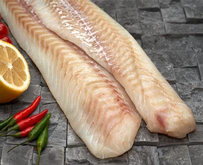 ТРЕСКА филе без кожи инд. заморозка (коробка 7 кг)