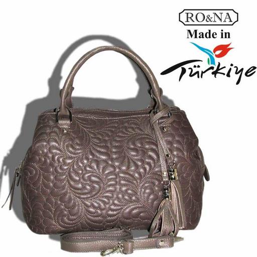 Женская кожаная сумка с перфорацией - дутая