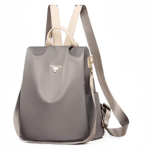 Женская противоугонная сумка рюкзак - классическая модель из ткани