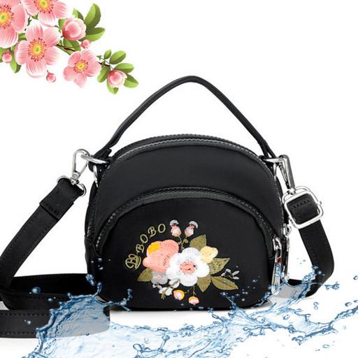 Маленькая женская сумка из водоотталкивающей ткани с цветами