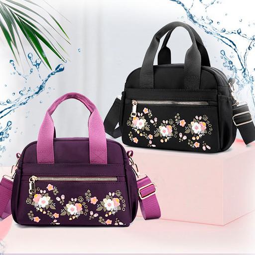 Женская сумка с наружными карманами